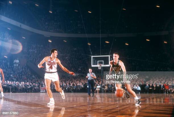 Tom Heinsohn of the Boston Celtics dribbles as Dolph Schayes of the Syracuse Nationals defends during an NBA game on November 3 1957 at Onondaga War...