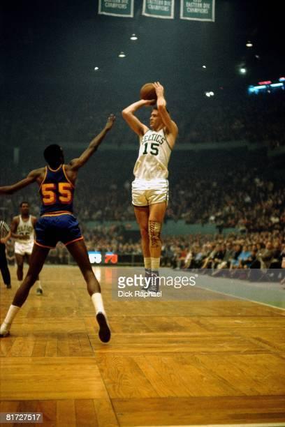 Tom Heinsohn of the Boston Celtics shoots a jump shot against the Golden State Warriors circa 1964 at the Boston Garden in Boston Massachusetts NOTE...