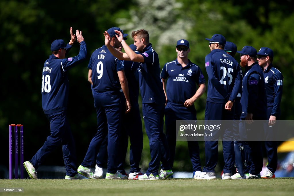 Tom Helm of Middlesex celebrates with his teammates after dismissing Adam Wheater of Essex during the Royal London One-Day Cup match between Middlesex and Essex at Radlett Cricket Club on May 17, 2018 in Radlett, England.