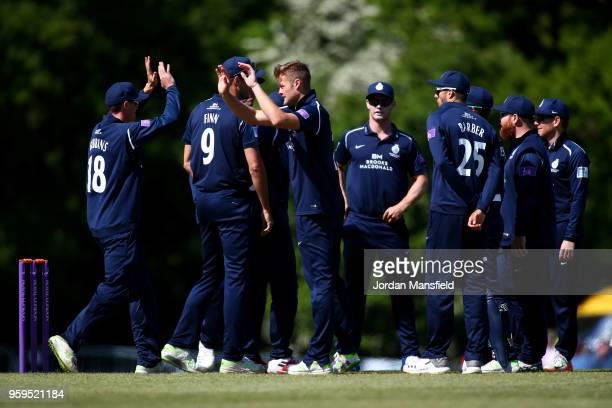 Tom Helm of Middlesex celebrates with his teammates after dismissing Adam Wheater of Essex during the Royal London OneDay Cup match between Middlesex...