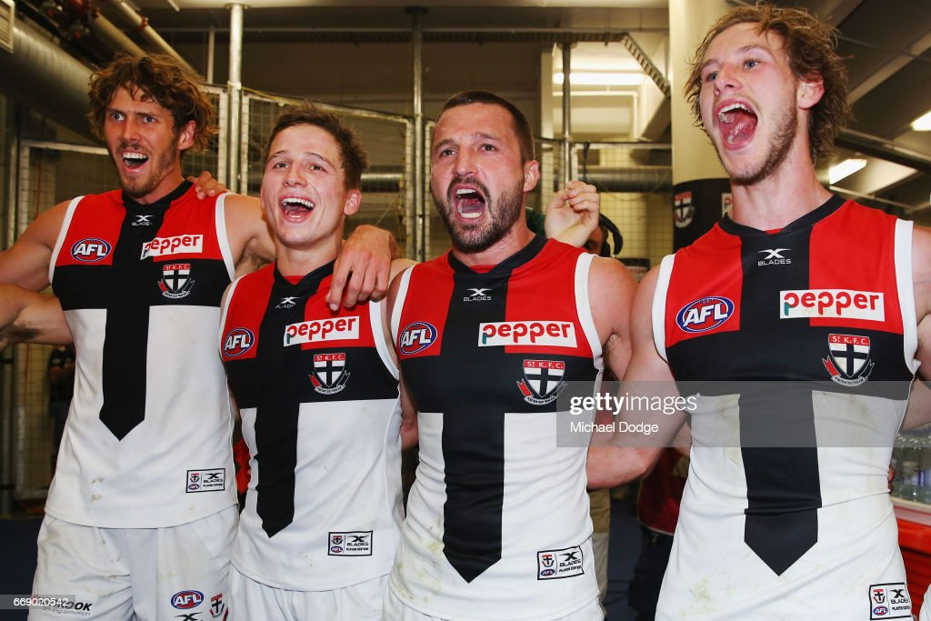 Tom Hickey (L) Jack Billings, Jarryn Geary and Jimmy Webster of the Saints (R) sing the club song after winning during the round four AFL match between the Collingwood Magpies and the St Kilda Saints at Etihad Stadium on April 16, 2017 in Melbourne, Australia.