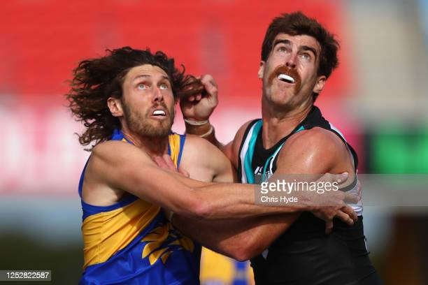Tom Hickey of the Eagles and Scott Lycett of the Power compete for the ball during the round 4 AFL match between the Port Adelaide Power and the West...