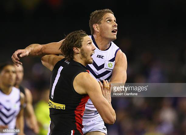 Tom Hickey of the Saints and Aaron Sandilands of the Dockers compete for the ball during the round 19 AFL match between the St Kilda Saints and the...