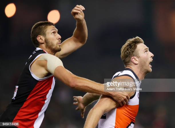 Tom Hickey of the Saints and Dawson Simpson of the Giants compete in a ruck contest during the 2018 AFL round five match between the St Kilda Saints...