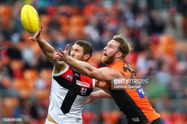Tom Hickey of the Saints and Dawson Simpson of the Giants contest the ball during the round 19 AFL match between the Greater Western Sydney Giants...