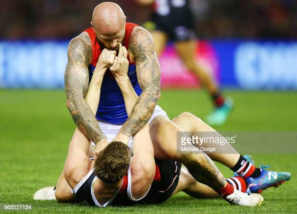 Tom Hickey of the Saints and Max Gawn of the Demons compete for the ball during the round seven AFL match between St Kilda Saints and the Melbourne...