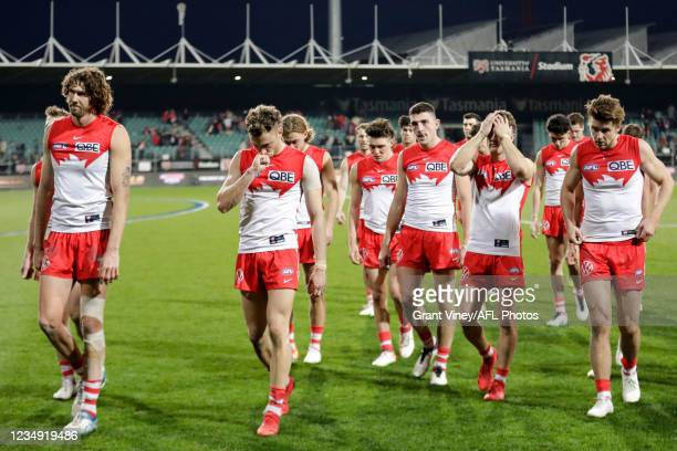 Tom Hickey of the Swans and Will Hayward of the Swans looks dejected after a loss during the 2021 AFL Second Elimination Final match between the...