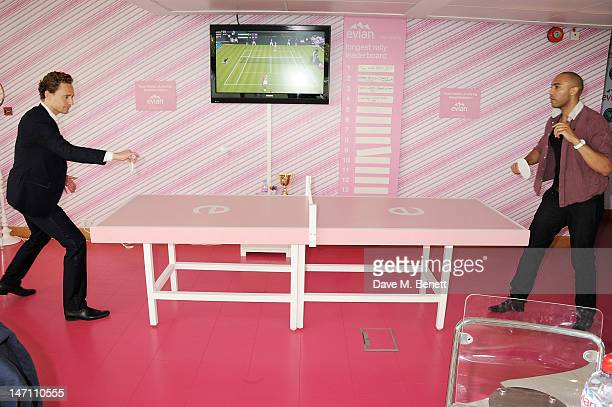 Tom Hiddleston and Alex Lanipekun attend the evian 'Live young' VIP Suite at Wimbledon on June 25 2012 in London England