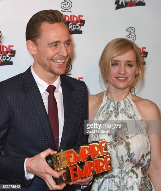 Tom Hiddleston and AnneMarie Duff pose in the winners room at the THREE Empire awards at The Roundhouse on March 19 2017 in London England