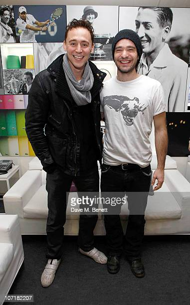 Tom Hiddleston and Charlie Cox at the Lacoste VIP Lounge at the ATP World Tour Finals in the O2 Arena on November 27 2010 in London England