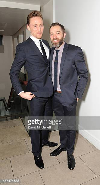 Tom Hiddleston and Hadley Fraser attend the after party on the press night of Coriolanus at The Hospital Club on December 17 2013 in London England