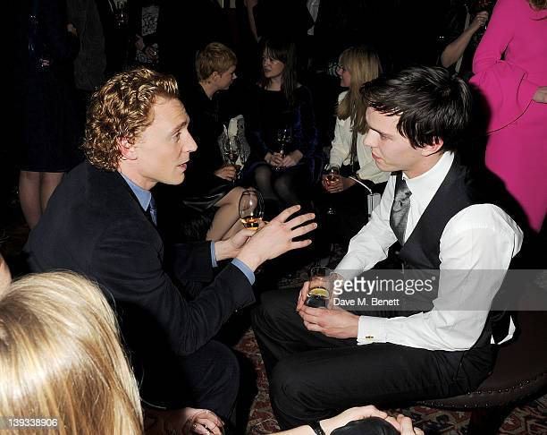 Tom Hiddleston and Nicholas Hoult attend a dinner following the Mulberry Autumn/Winter 2012 show during London Fashion Week at The Savile Club on...