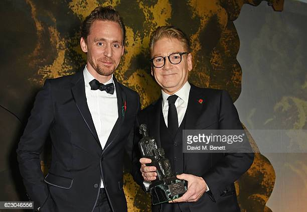 Tom Hiddleston and Sir Kenneth Branagh, winner of the Lebedev Award, pose onstage at the 62nd London Evening Standard Theatre Awards, recognising...