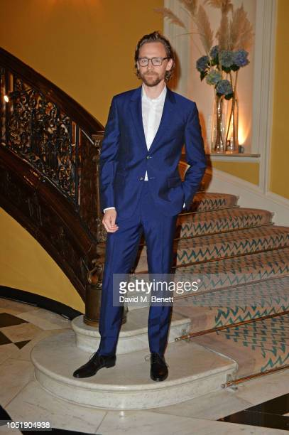 Tom Hiddleston attends the Michael Kors cocktail party to celebrate the collaboration with David Downton at Claridge's Hotel on October 11 2018 in...