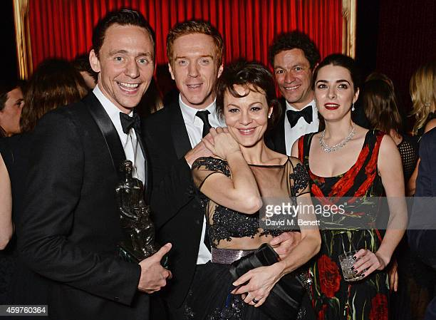 Tom Hiddleston Damian Lewis Helen McCrory Dominic West and Bee Shaffer attend an after party following the 60th London Evening Standard Theatre...