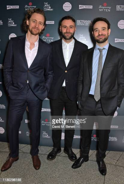 Tom Hiddleston Eddie Arnold and Charlie Cox attend the press night after party for Betrayal at The Cafe In The Crypt St MartinintheFields on March 13...