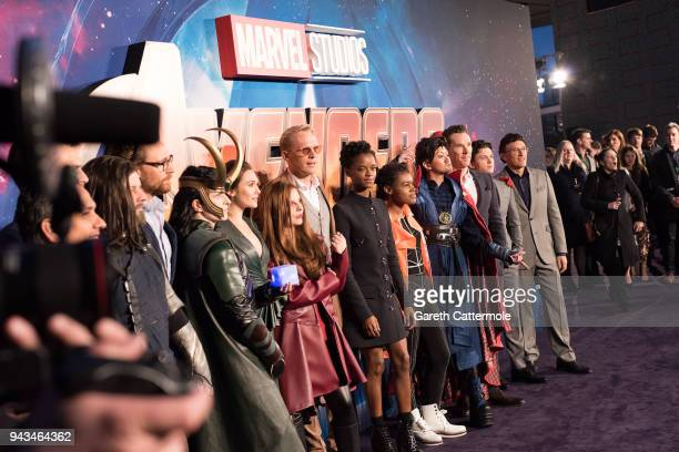 Tom Hiddleston Elizabeth Olsen Paul Bettany Letitia Wright Benedict Cumberbatch and Tom Holland with cosplayers attend the UK Fan Event to celebrate...