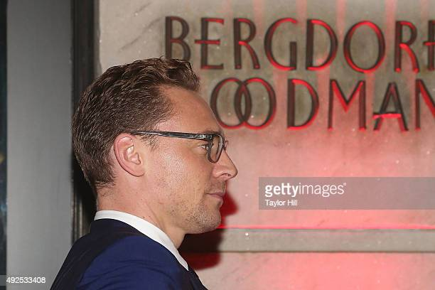 Tom Hiddleston eyeglasses detail attends a celebration of Bergdorf Goodman Windows inspired by the Legendary Pictures and Universal Pictures film...