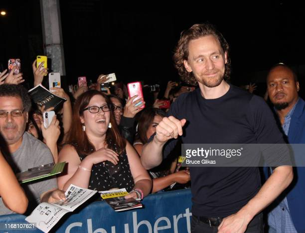 Tom Hiddleston greets and signs autographs for fans after the first public preview of Harold Pinter's classic play Betrayalon Broadway at The Bernard...