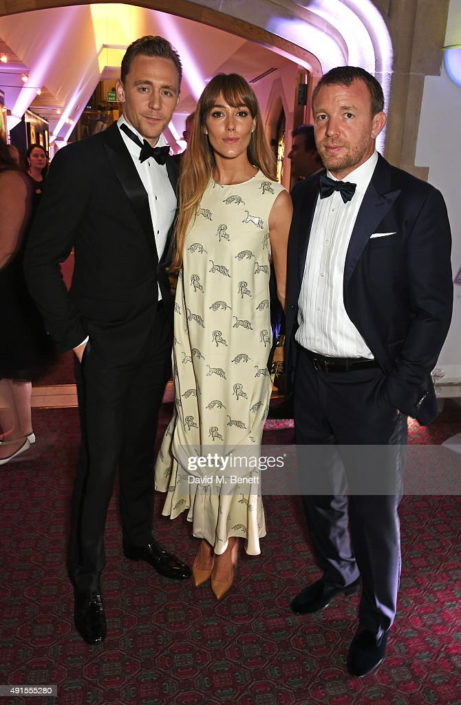 Tom Hiddleston, Jacqui Ainsley and Guy Ritchie attend a cocktail reception at the BFI Luminous Fundraising Gala in partnership with IWC and crystals by Swarovski at The Guildhall on October 6, 2015 in London, England.