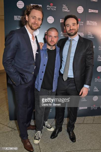 Tom Hiddleston Jamie Lloyd and Charlie Cox attend the press night after party for Betrayal at The Cafe In The Crypt St MartinintheFields on March 13...