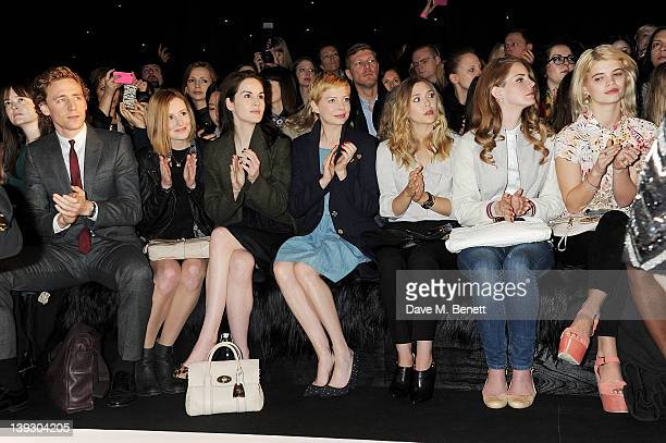 Tom Hiddleston Laura Carmichael Michelle Dockery Michelle Williams Elizabeth Olsen Lana Del Rey and Pixie Geldof sit in the front row at the Mulberry...