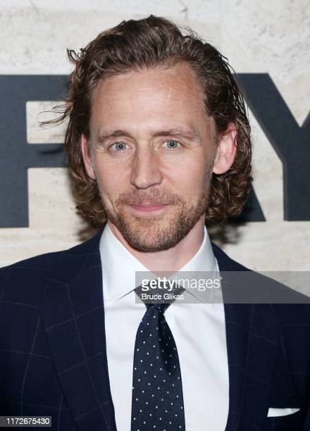 """Tom Hiddleston poses at The Opening Night of """"Betrayal"""" on Broadway at THE POOL at the Seagram Building on September 5, 2019 in New York City."""