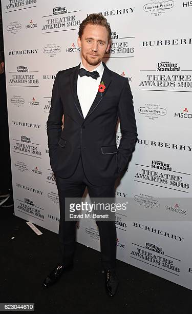 Tom Hiddleston poses in front of the winners boards at The 62nd London Evening Standard Theatre Awards recognising excellence from across the world...