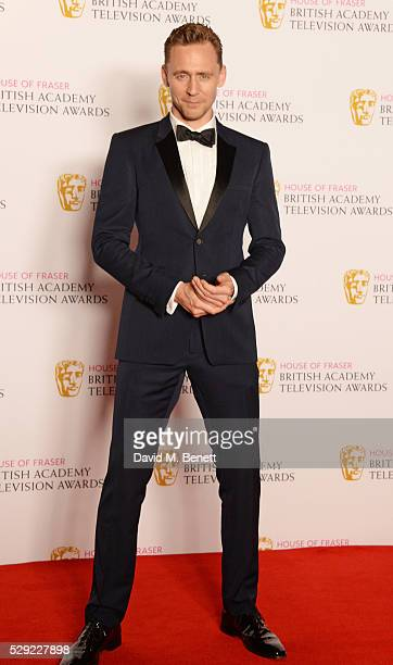 Tom Hiddleston poses in the winners room at the House Of Fraser British Academy Television Awards 2016 at the Royal Festival Hall on May 8 2016 in...