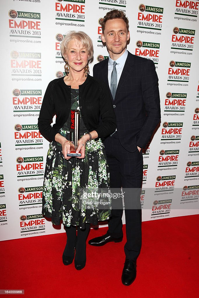 Tom Hiddleston poses with Dame Helen Mirren in the press room after presenting her with the Empire Legend Award at the Jameson Empire Awards 2013 at Grosvenor House Hotel on March 24, 2013 in London, England.