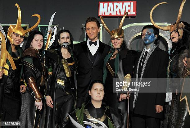"""Tom Hiddleston poses with Looki-Loki's at the World Premiere of """"Thor: The Dark World"""" at Odeon Leicester Square on October 22, 2013 in London,..."""