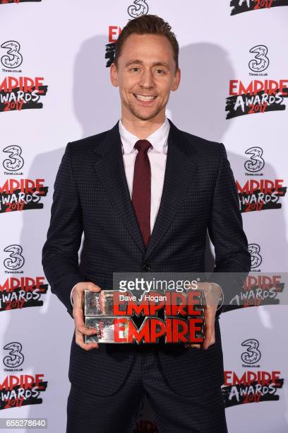Tom Hiddleston poses with the awards for Empire Hero and Best TV Series - The Night Manager in the winners room at the THREE Empire awards at The...