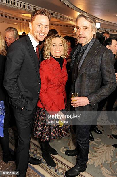 Tom Hiddleston Sinead Cusack and Jeremy Irons arrive at the 2013 South Bank Sky Arts Awards at The Dorchester on March 12 2013 in London England