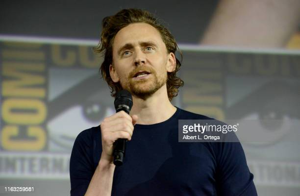 Tom Hiddleston speaks at the Marvel Studios Panel during 2019 ComicCon International at San Diego Convention Center on July 20 2019 in San Diego...