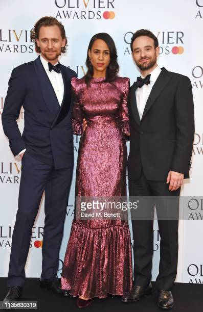 Tom Hiddleston Zawe Ashton and Charlie Cox pose in the press room at The Olivier Awards 2019 with Mastercard at The Royal Albert Hall on April 7 2019...