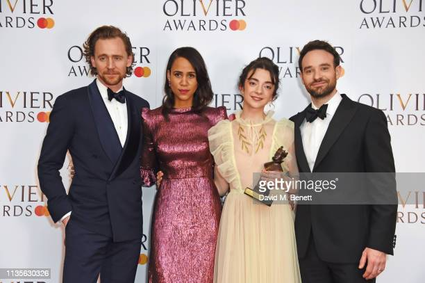 Tom Hiddleston Zawe Ashton Patsy Ferran winner of the Best Actress award for 'Summer And Smoke' and Charlie Cox pose in the press room at The Olivier...