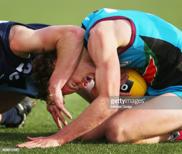 Tom HIGHMORE of the Allies is tackled high during the U18 AFL Championships match between Vic Metro and the Allies at Simonds Stadium on July 5 2017...