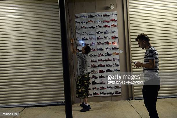 Tom Hijaz and Mehmoud Elodeh check on a clothing and shoe store following the floods on August 16, 2016 in Baton Rouge, Louisiana. The expanding...