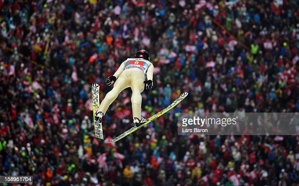 Tom Hilde of Norway competes during the first round for the FIS Ski Jumping World Cup event of the 61st Four Hills ski jumping tournament at...