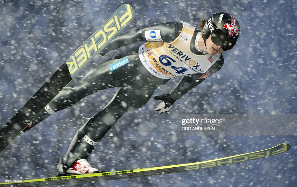 Tom Hilde of Norway jumps during the training run at the FIS Ski Jumping World Cup on the Muehlenkopfschanze hill in Willingen, western Germany, on February 8, 2013. Heavy snowfall made the conditions challenging for the athletes.