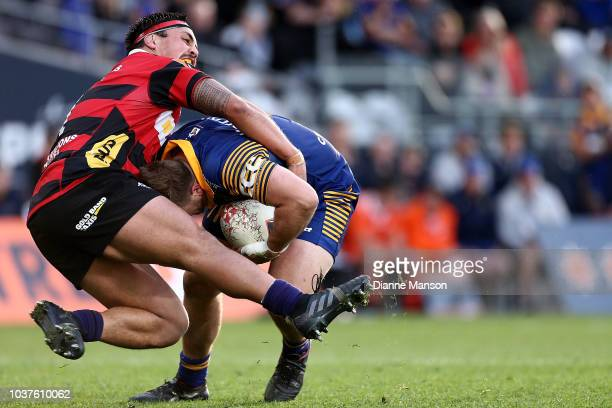 Tom Hill of Otago is tackled by Daniel LienertBrown of Canterbury during the round six Mitre 10 Cup match between Otago and Canterbury at Forsyth...
