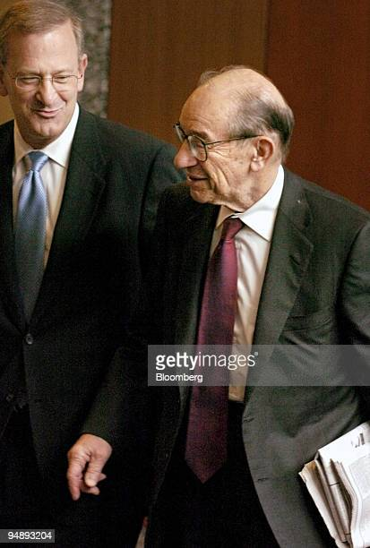 Tom Hoenig president of the Federal Reserve Bank of Kansas City left walks with Federal Reserve Board Chairman Alan Greenspan as the two make their...