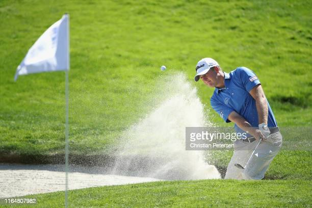 Tom Hoge of the United States chips from the bunker onto the 18th green during the final round of the Barracuda Championship at Montreux Country Club...