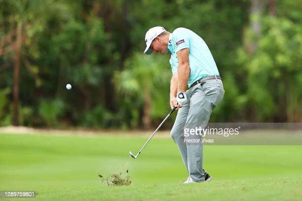 Tom Hoge of the United States plays a shot on the first hole during the final round of the Mayakoba Golf Classic at El Camaleón Golf Club on December...