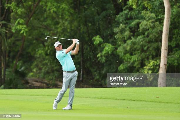 Tom Hoge of the United States plays a shot on the seventh hole during the final round of the Mayakoba Golf Classic at El Camaleón Golf Club on...