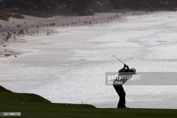 Tom Hoge of the United States plays his second shot on the ninth hole during the third round of the AT&T Pebble Beach Pro-Am at Pebble Beach Golf...