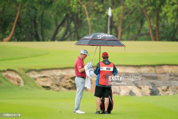 Tom Hoge of the United States prepares to play his second shot on the sixth hole during the second round of the Mayakoba Golf Classic at El Camaleón...