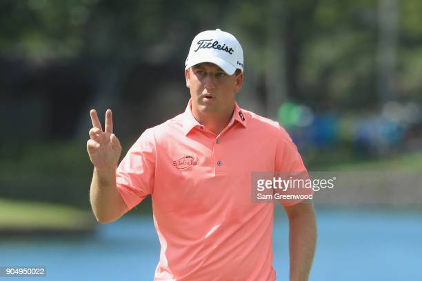 Tom Hoge of the United States reacts after a birdie putt on the second green during the final round of the Sony Open In Hawaii at Waialae Country...