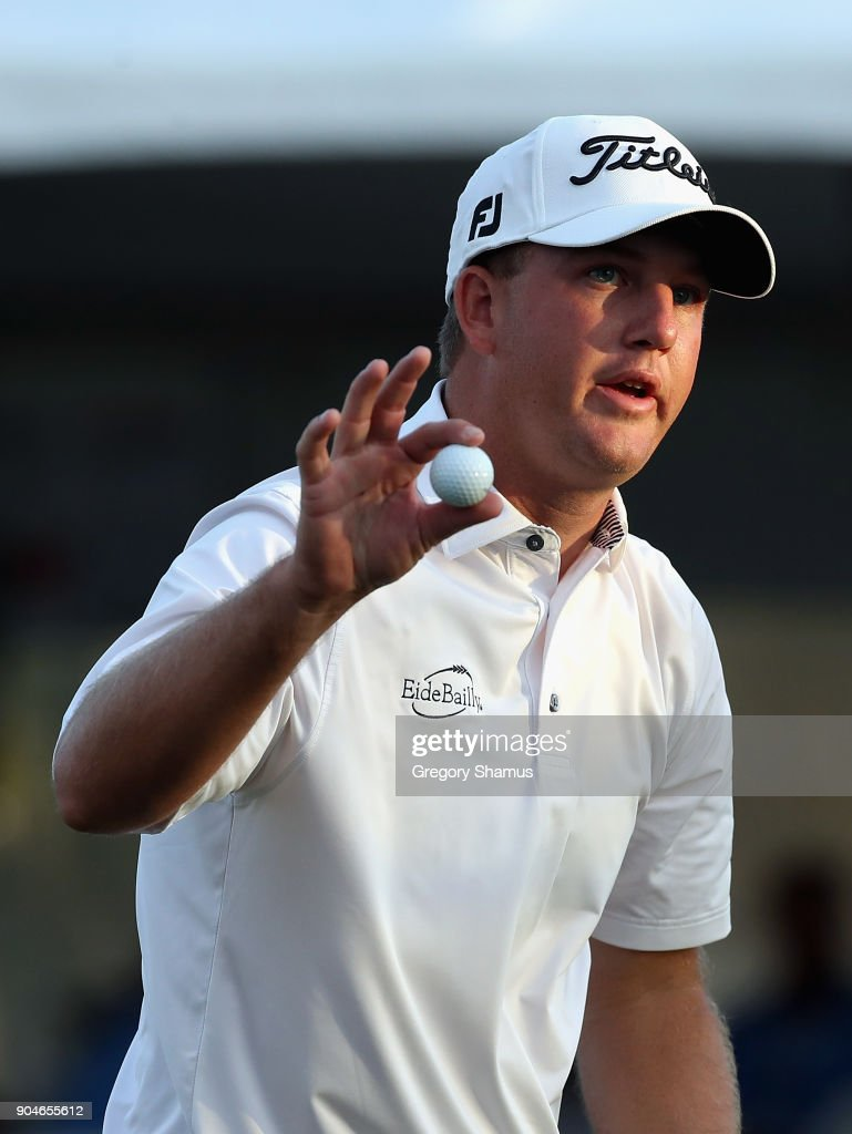 Tom Hoge of the United States reacts after making a birdie putt on the 18th green during round three of the Sony Open In Hawaii at Waialae Country Club on January 13, 2018 in Honolulu, Hawaii.