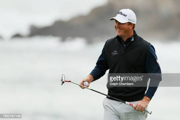 Tom Hoge of the United States reacts on the 18th green during the final round of the AT&T Pebble Beach Pro-Am at Pebble Beach Golf Links on February...